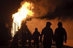 Silhueta dos sapadores-bombeiros na ação Imagem de Stock Royalty Free