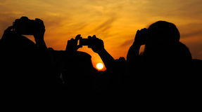 Silhueta e por do sol fotografia de stock royalty free