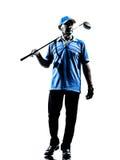 Silhueta golfing do jogador de golfe do homem Fotografia de Stock Royalty Free