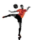 Silhueta isolada homem do jogador de futebol Foto de Stock