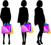 Silhueta preta da jovem mulher com sacos de compras Fotos de Stock Royalty Free