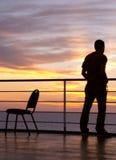 Silhueta preta do homem e da cadeira Foto de Stock Royalty Free