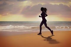 Silhueta Running da menina Foto de Stock Royalty Free