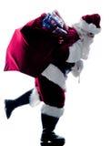Silhueta running de Papai Noel isolada Fotos de Stock