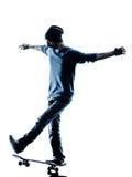 Silhueta skateboarding do skater do homem Foto de Stock Royalty Free