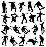 Silhueta Skateboarding, skateres, esporte extremo Foto de Stock Royalty Free