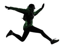 Silhueta trekking de corrida do corredor da mulher fotos de stock royalty free