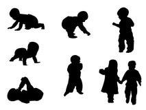 Silhuetas - bebê Imagens de Stock