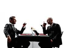 Silhuetas bebendo do jantar do vinho do negócio Foto de Stock