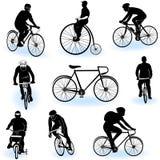 Silhuetas Bicycling Fotografia de Stock Royalty Free