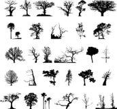 Silhuetas da árvore ajustadas Imagens de Stock