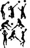 Silhuetas da fêmea do voleibol Imagens de Stock Royalty Free