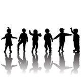Silhuetas das crianças e das sombras Fotografia de Stock Royalty Free