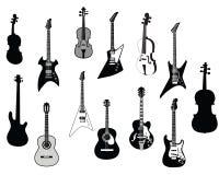Silhuetas das guitarra Fotografia de Stock Royalty Free