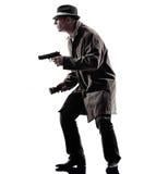 Silhuetas das investigações de criminosos do homem do detetive Foto de Stock Royalty Free