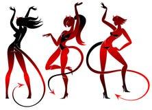 Silhuetas das meninas de dança do diabo ajustadas Fotos de Stock Royalty Free