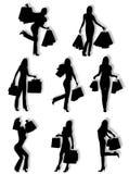 Silhuetas das mulheres da compra Fotografia de Stock Royalty Free