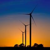 Silhuetas das turbinas de vento Fotografia de Stock Royalty Free