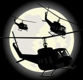 Silhuetas de helicópteros militares ilustração stock