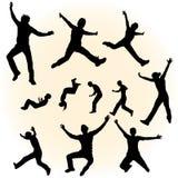Silhuetas de povos de salto Fotografia de Stock Royalty Free