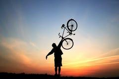Silhuetas de um ciclista Fotos de Stock