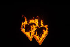 silhuetas dequeimadura do coração Fotos de Stock Royalty Free