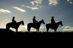 Silhuetas do cowboy foto de stock royalty free