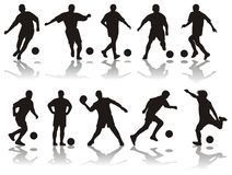 Silhuetas do futebol Imagem de Stock