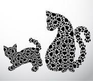 Silhuetas do gato e dos gatinhos das patas do gato Foto de Stock