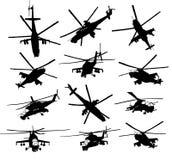 Silhuetas do helicóptero ajustadas Fotografia de Stock