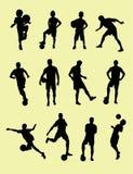 Silhuetas do jogador de futebol Fotografia de Stock Royalty Free