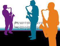 Silhuetas do jogador do saxofone Imagem de Stock