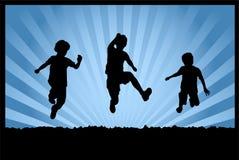 Silhuetas do salto das crianças Imagens de Stock Royalty Free