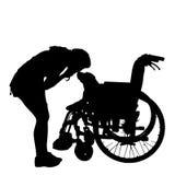 Silhuetas do vetor do cão em uma cadeira de rodas Imagens de Stock Royalty Free