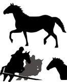 Silhuetas dos cavalos Foto de Stock