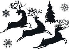 Silhuetas dos cervos e do floco de neve Imagem de Stock Royalty Free