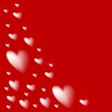 Silhuetas dos corações em um fundo vermelho Fotografia de Stock Royalty Free