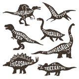 Silhuetas dos dinossauros com rotulação Fotografia de Stock Royalty Free