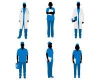 Silhuetas dos doutores no branco ilustração royalty free
