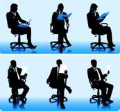 Silhuetas dos homens de negócios Imagem de Stock