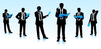 Silhuetas dos homens de negócios Imagens de Stock