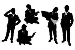 Silhuetas dos homens de negócios Foto de Stock Royalty Free