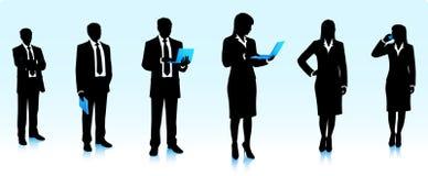 Silhuetas dos homens de negócios com computadores Foto de Stock
