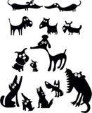 Silhuetas engraçadas do cão Fotografia de Stock Royalty Free