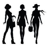 Silhuetas pretas de mulheres bonitas ilustração do vetor