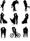 Silhuetas românticas dos pares Fotografia de Stock