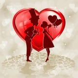 Silhuetas vermelhas do coração de dois amantes Fotografia de Stock Royalty Free