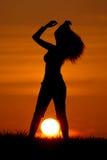 Silhuette bij zonsondergang Stock Foto