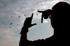 Silhuette con baloons imagenes de archivo