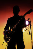 Silhouette of guitar player. With reflectors in back royalty free stock photography